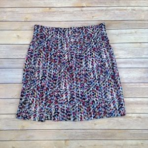 Cabi pull on overlapping multi color skirt